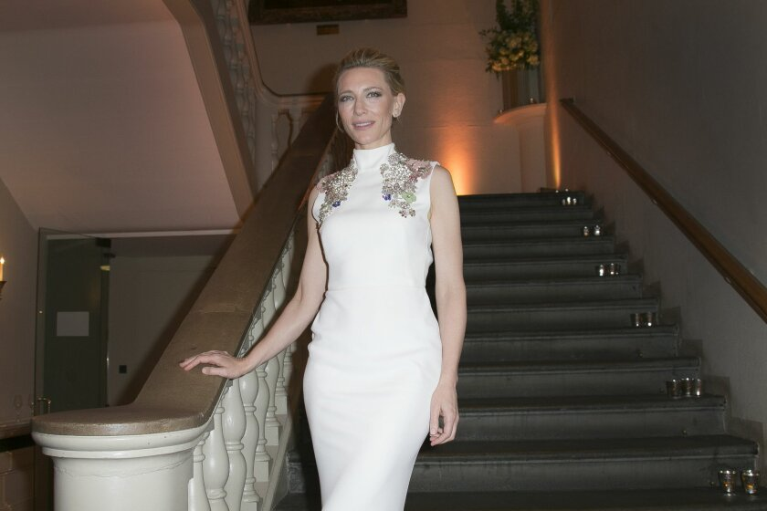 Cate Blanchett poses on the stairs at Banqueting House in central London, for photographers upon arrival at the London Film Festival Awards, Saturday, Oct. 17, 2015. (Photo by Joel Ryan/Invision/AP)