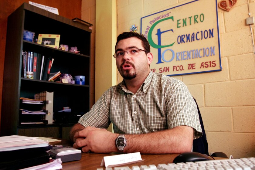 FILE - In this Tuesday Oct. 24, 2006 file photo, Roman Catholic priest Antonio Rodriguez Tercero explains the function of the youth center in the San Salvador suburb Mejicanos, El Salvador. Police in El Salvador arrested the Spanish priest, Wednesday, July 30, 2014, on charges he tried to get favorable treatment for gang members and smuggled contraband into prisons. The priest had been involved in programs aimed at rehabilitating gang members. (AP Photo/Luis Romero, File)
