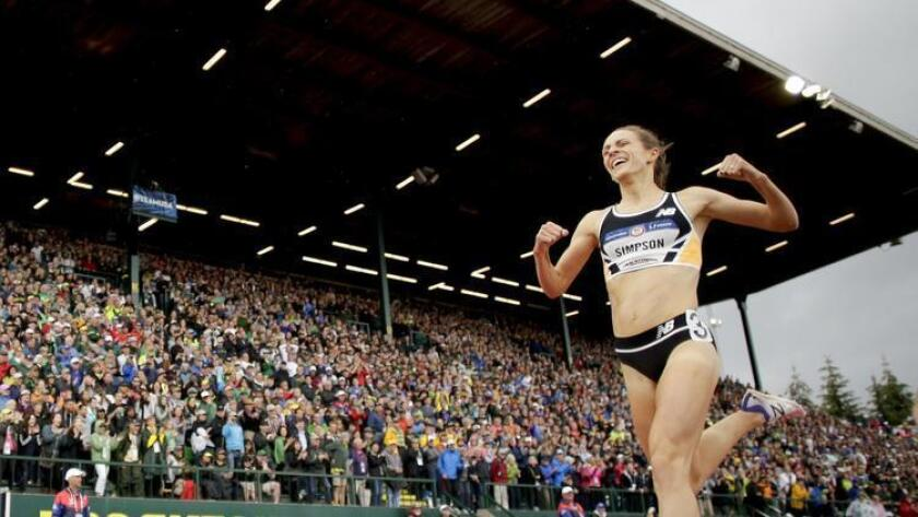 Jenny Simpson celebrates as she wins in the finals of the women's 1500-meter run at the U.S. Olympic Track and Field Trials, Sunday, July 10, 2016, in Eugene Ore. (AP Photo/Matt Slocum) (Matt Slocum / AP)