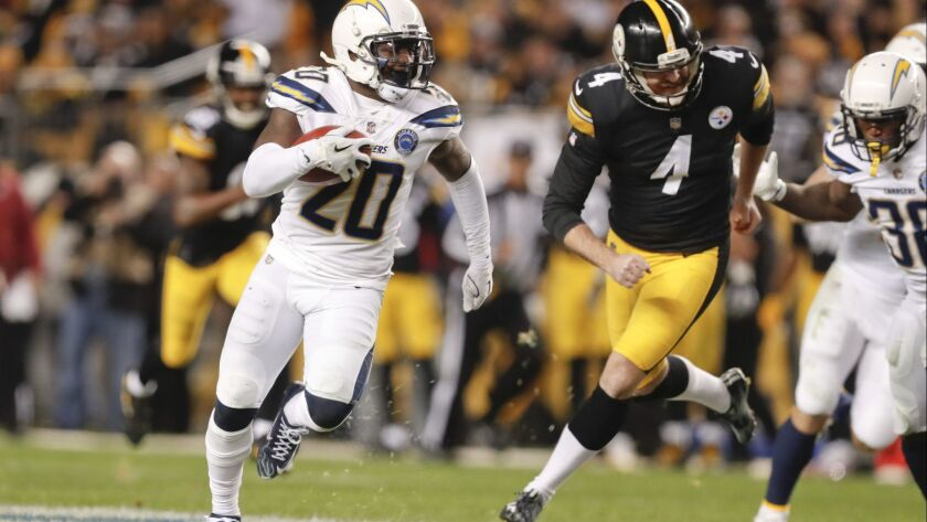 Los Angeles Chargers' Desmond King (20) runs past Pittsburgh Steelers punter Jordan Berry (4) to ret