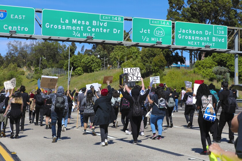 Protestors in La Mesa walked onto eastbound lanes of Interstate 8 on May 30.