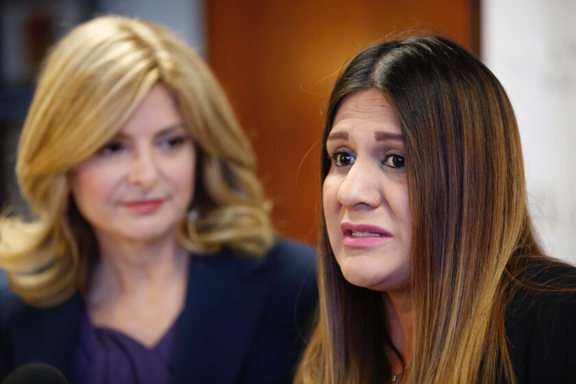 Monica Ochoa, right, a Lynwood city employee, seen here with her attorney, Lisa Bloom, speaks at a news conference in February to discuss allegations of sexual harassment against City Councilman Edwin Hernandez.