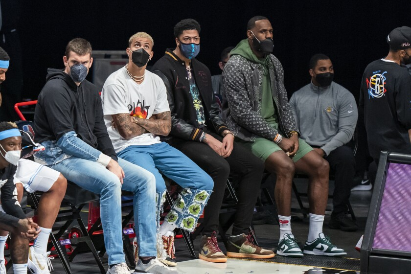 Los Angeles Lakers center Marc Gasol, forward Kyle Kuzma, forward Anthony Davis and forward LeBron James sit on the bench during the first half of the team's NBA basketball game against the Brooklyn Nets, Saturday, April 10, 2021, in New York (AP Photo/Corey Sipkin).