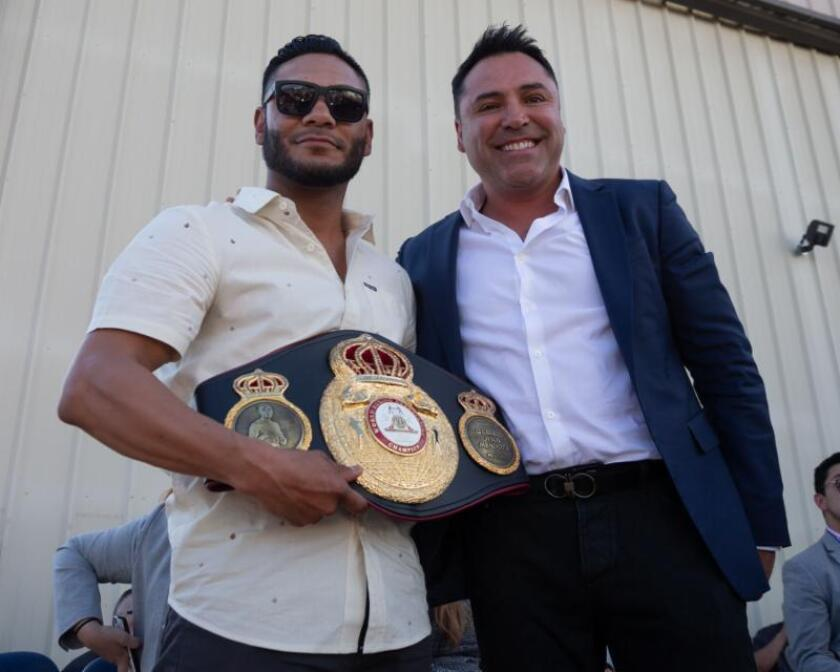 Andrew Cancio, left, poses with Oscar De La Hoya during an event this summer in Blythe, Calif.