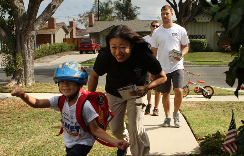 Janet Nguyen, shown going door-to-door while campaigning, won a key state Senate race that prevented the Democrats from regaining a supermajority in the state Senate.