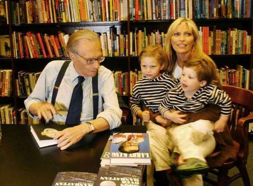 Larry King, pictured with his family at a 2003 book signing, is 26 years older than his wife, Shawn Southwick. A team of researchers believes that men's preferences for younger mates may explain the origin of menopause.