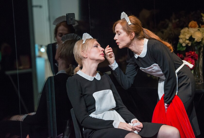 """Cate Blanchett, left, and Isabelle Huppert in the Sydney Theatre Company's production of """"The Maids"""" by Jean Genet presented by Lincoln Center Festival 2014 at New York City Center."""
