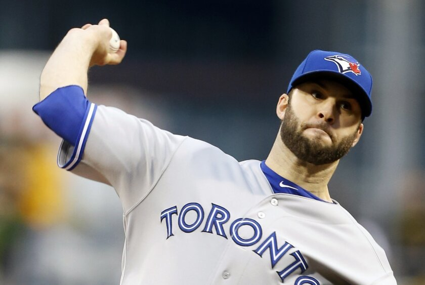 Toronto Blue Jays starting pitcher Brandon Morrow throws against the Pittsburgh Pirates in the first inning of a baseball game on Friday, May 2, 2014, in Pittsburgh. (AP Photo/Keith Srakocic)