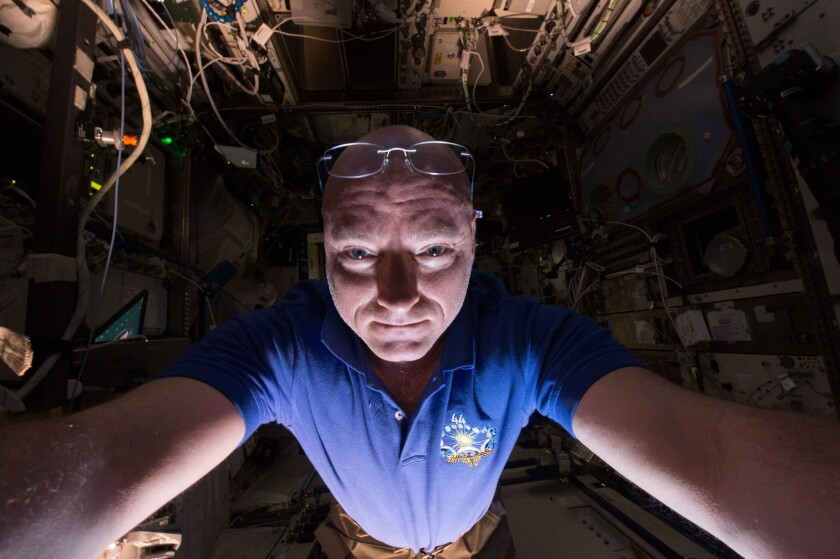 Astronaut Scott Kelly prepares a scientific experiment on the International Space Station.