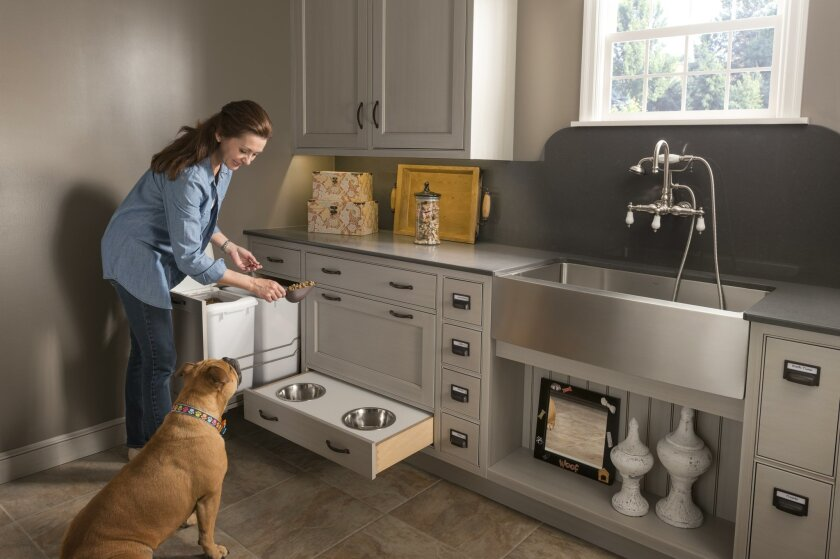 A laundry room can be remodeled for feeding and bathing pets.