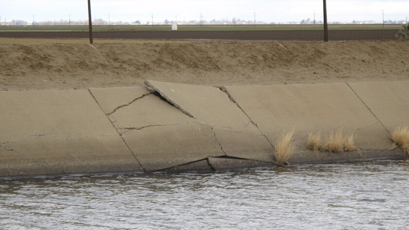 A buckle in the lining of the Delta Mendota Canal, seen in this photo taken in December, is caused by sinking land. Years of drought and heavy reliance on groundwater pumping have made the land sink faster than ever up and down California's Central Valley.