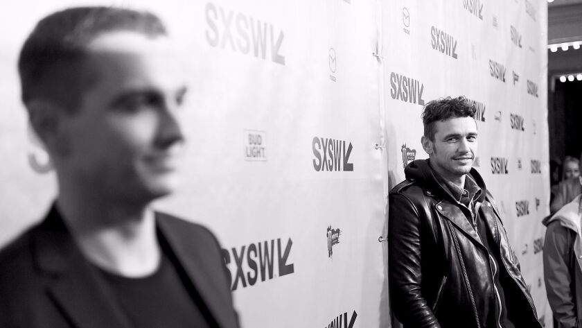 """James Franco eyes his brother Dave on the press line at the SXSW premiere of their film, """"The Disaster Artist."""""""