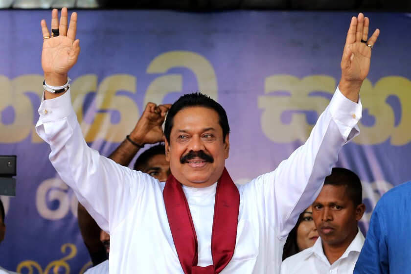 Sri Lankan parliamentary candidate Mahinda Rajapaksa, the country's former leader, waves to supporters at a campaign rally in Kandy on Aug. 14.