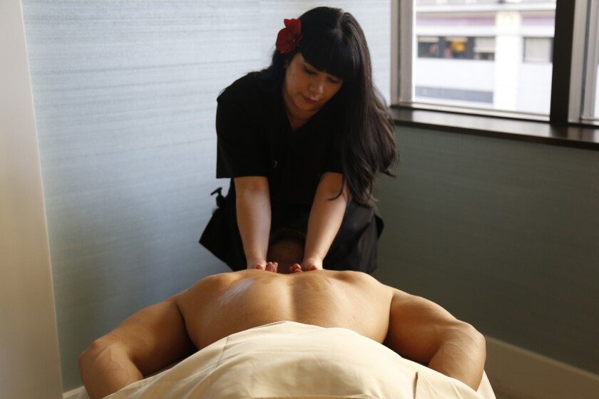 Ian relaxes during a couple's massage at AquaVie in downtown San Diego.