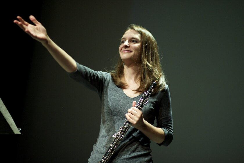 """Oboist Karisa Werdon at the conclusion of a performance of Rand Steiger's """"Nested Etudes for Oboe"""" at UCSD's Calit2 on Dec. 7"""