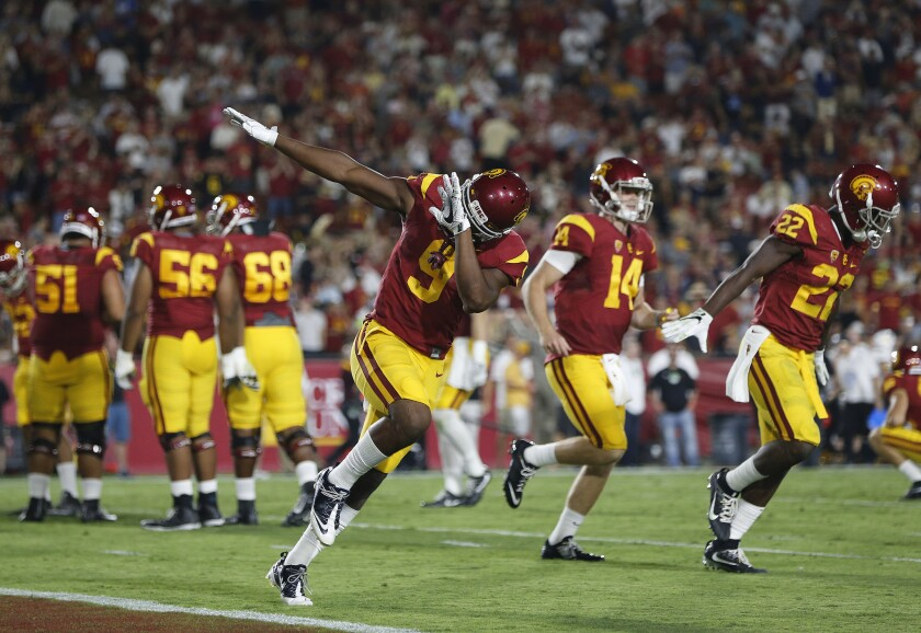 USC receiver JuJu Smith-Schuster (9) reacts after scoring a touchdown against Arizona State during the first half of a game at the Coliseum on Oct. 1.