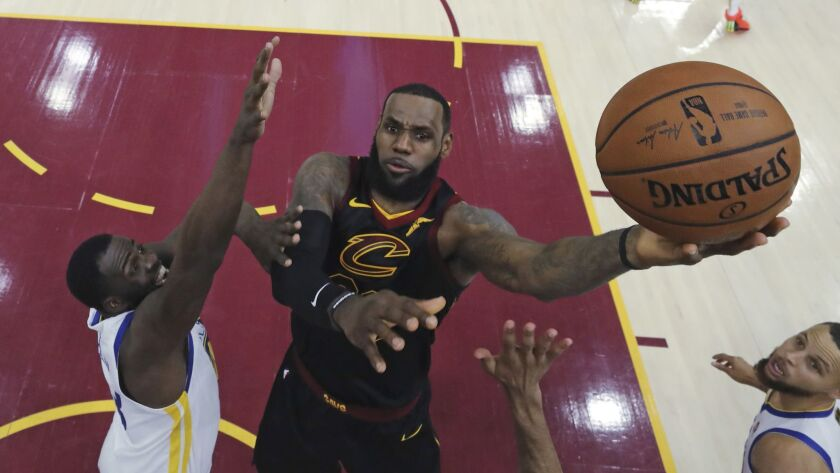 FILE - In this June 6, 2018, file photo, Cleveland Cavaliers' LeBron James shoots against Golden Sta