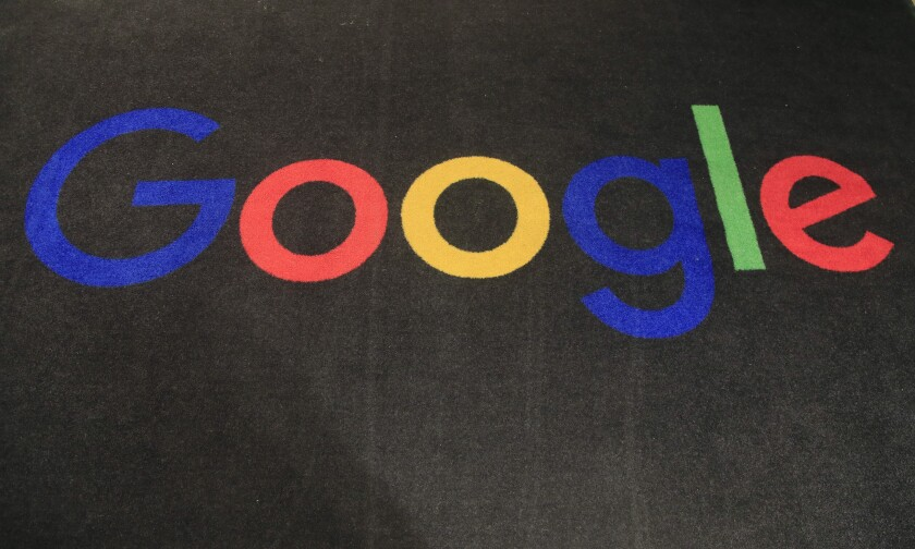 FILE - In this Monday, Nov. 18, 2019 file photo, the logo of Google is displayed on a carpet at the entrance hall of Google France in Paris. Ireland's Data Protection Commission said Tuesday Feb. 4, 2020, they have launched separate inquiries into Google and dating app Tinder over their processing of user data, in a fresh round of regulatory scrutiny aimed at tech companies. (AP Photo/Michel Euler, File)