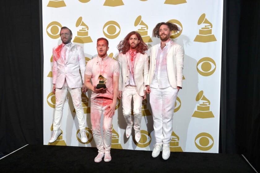 Ben McKee, Dan Reynolds, Wayne Sermon and Daniel Platzman of Imagine Dragons pose backstage at the Grammy Awards presentation.
