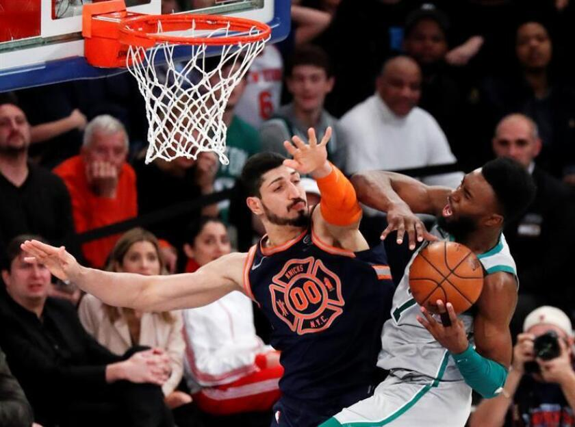 Boston Celtics guard Jaylen Brown (R) is fouled by New York Knicks center Enes Kanter of Turkey (L) in the second half of their NBA basketball game between the Boston Celtics and the New York Knicks at Madison Square Garden in New York, New York, USA. EFE