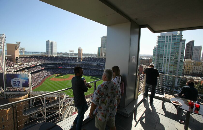 Staff who work in the DiamondView tower next to Petco Park take time off from work to watch Opening Day against the San Francisco Giants.