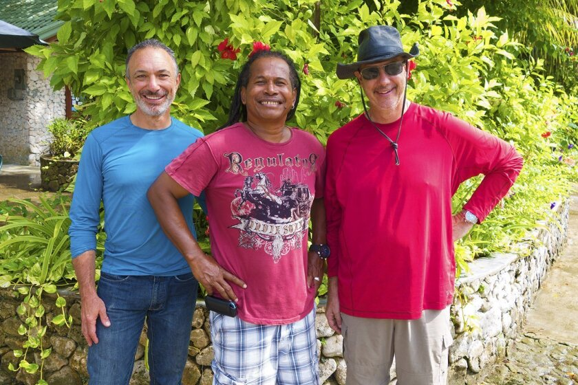 Jonathan Rudin (left), Gowwin (no last name given) and John Marsden. Gowwin is a native of the island of Peleliu and a hotel owner. He gave Rudin and Marsden a tour of the caves.