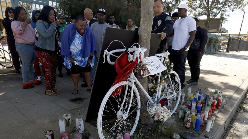 Beverly Owens, the mother of bicyclist Frederick Frazier, is overcome with emotion as she visits the site of the hit-and-run incident that claimed the life of her 22-year-old son.