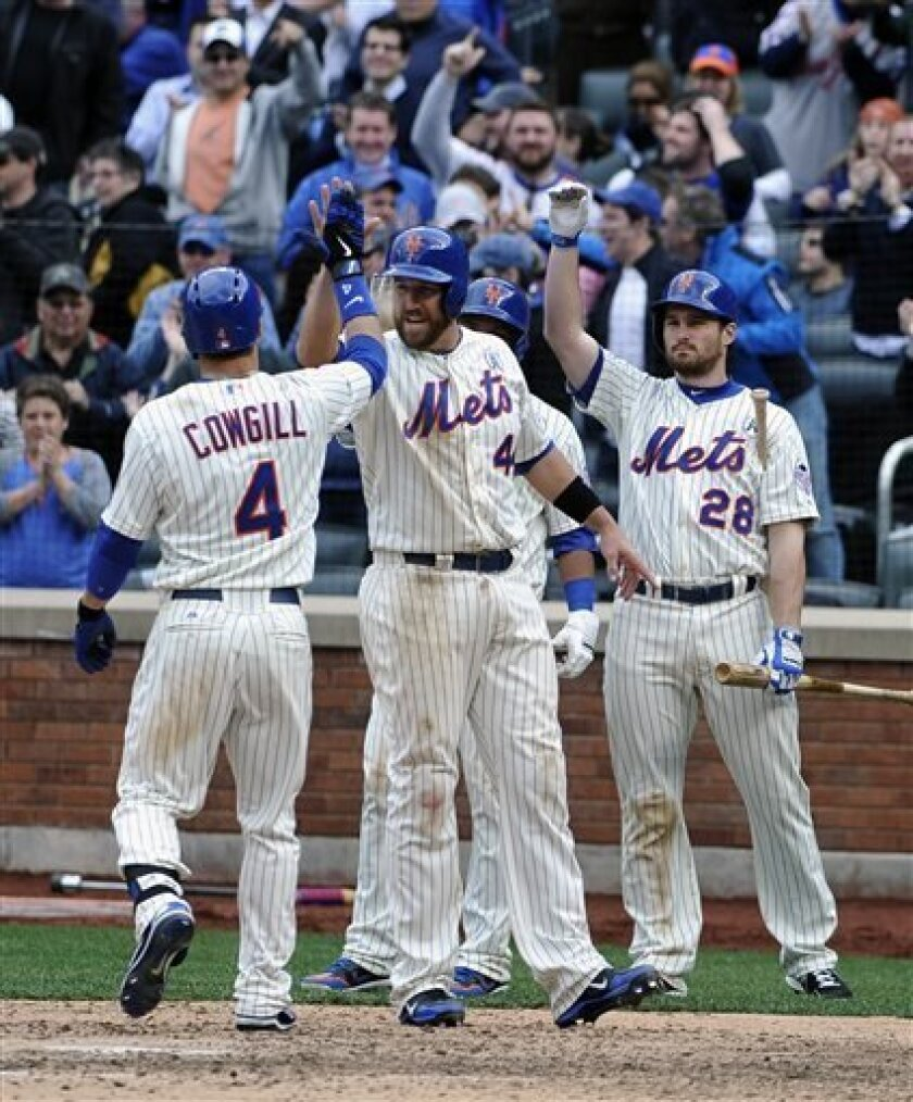 New York Mets' John Buck (44) and Daniel Murphy (28) greet Collin Cowgill (4) at home plate after Cowgill hit a grand slam off San Diego Padres relief pitcher Brad Brach scoring Buck, Reuben Tejada and Jordany Valdespin in the seventh inning of an opening day baseball game at Citi Field on Monday,