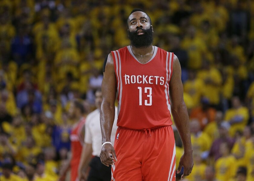 Houston Rockets guard James Harden (13) walks on the floor during the second half of Game 5 of the NBA basketball Western Conference finals against the Golden State Warriors in Oakland, Calif., Wednesday, May 27, 2015. (AP Photo/Ben Margot)