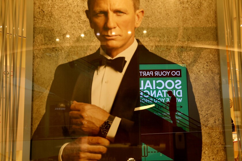 A poster promotes Omega watches and the new James Bond film featuring Daniel Craig, 'No Time to Die.'