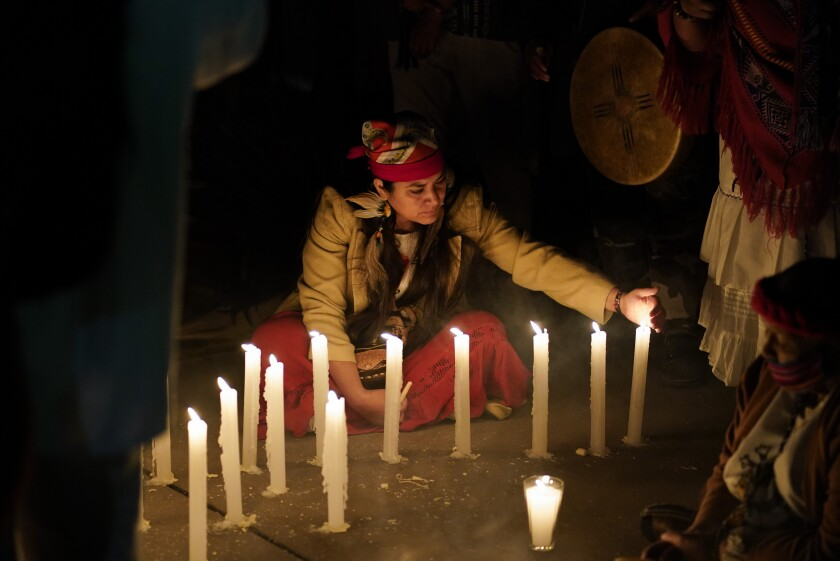 A woman takes part in a ceremony Friday marking the 500th anniversary of the fall in 1521 of the Aztec capital.