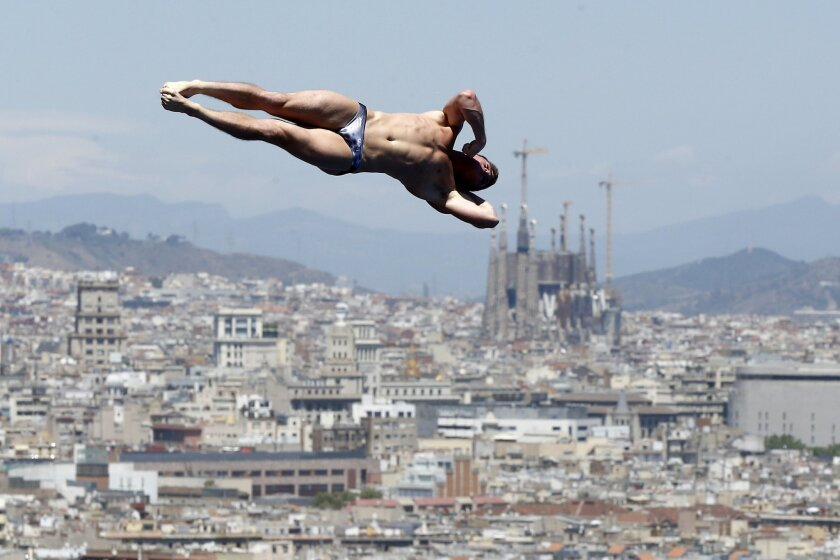 FILE - In this July 28, 2013, file photo, David Boudia performs during the men's 10-meter platform final at the FINA Swimming World Championships in Barcelona, Spain. As Boudia embarks on his third, and perhaps final Olympics quest, he's focused on bigger issues such as professional satisfaction an