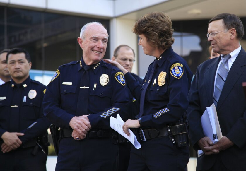 Shelley Zimmerman, second from right, and retiring Police Chief William Lansdowne at San Diego Police Department headquarters, Wednesday, Feb. 26, 2014, during an announcement that Zimmerman would be the department's new top officer.