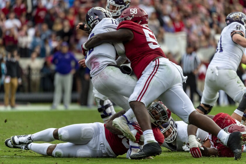 FILE - Alabama defensive lineman Christian Barmore (58) sacks Western Carolina quarterback Tyrie Adams (12) during the first half of an NCAA college football game in Tuscaloosa, Ala., in this Saturday, Nov. 23, 2019, file photo. Barmore is rated as the draft's best tackle among a weak group and could be gone unless the Browns move to get him. (AP Photo/Vasha Hunt, File)