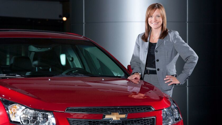 General Motors Senior Vice President Global Product Development Mary Barra with a 2011 Chevrolet Cru