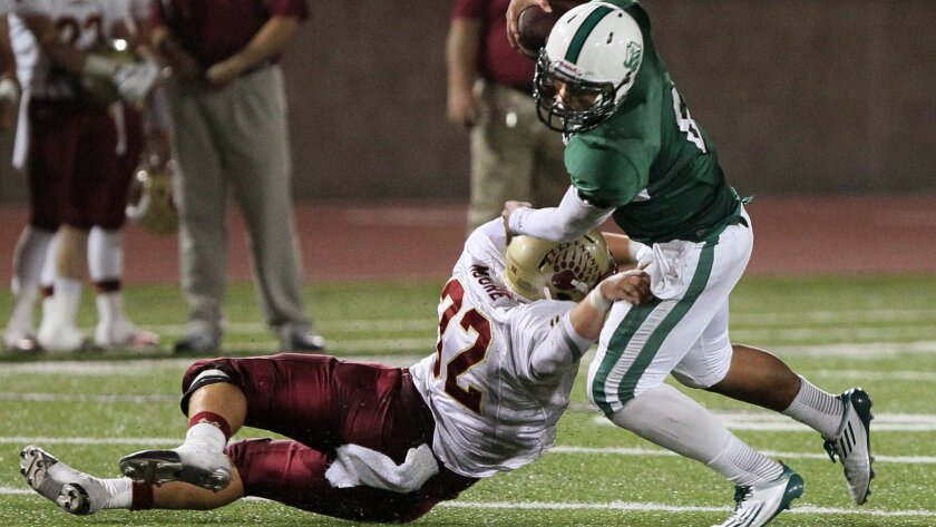 Mission Hills' Hunter Moore sacks Oceanside quarterback Israel Paopao.
