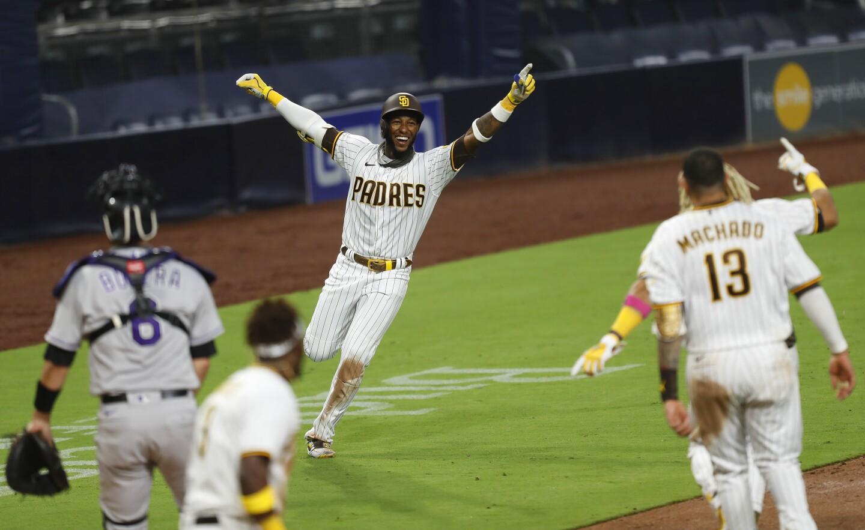 SAN DIEGO, CA - SEPTEMBER 07: San Diego Padres Jurickson Profar celebrates game-winning hit