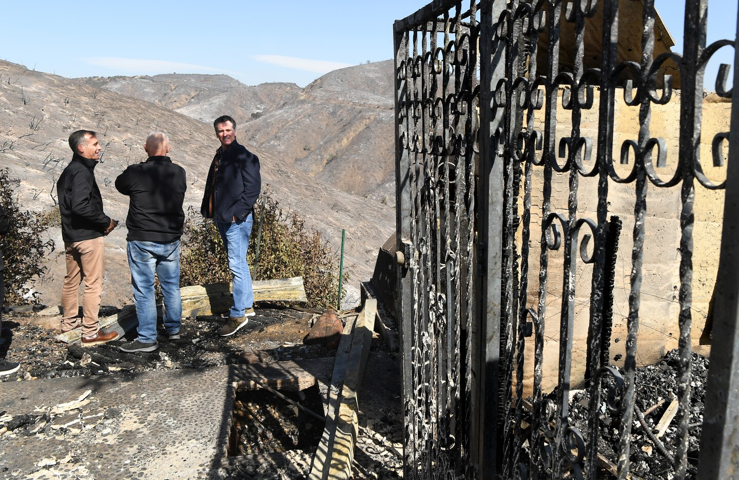 BRENTWOOD, CALIFORNIA OCTOBER 29, 2019-From left, L.A. Mayor Eric Garcetti, L.A. City Councilman Mike Bonin and California Governor Gavin Newsom view a burned and home along Tigertail Road in Brentwood Tuesday. (Wally Skalij/Los Angeles Times)