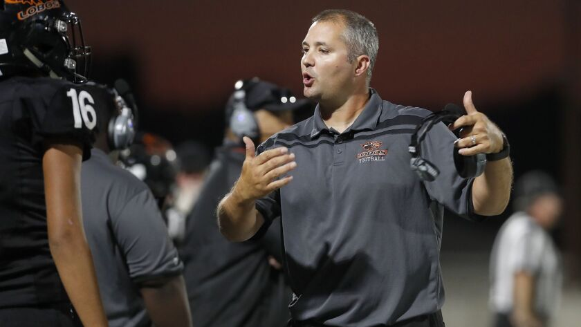 Carl Agnew, shown coaching against Saddleback High on Sept. 6, 2018, finished 57-65 in 11 seasons in charge of Los Amigos.