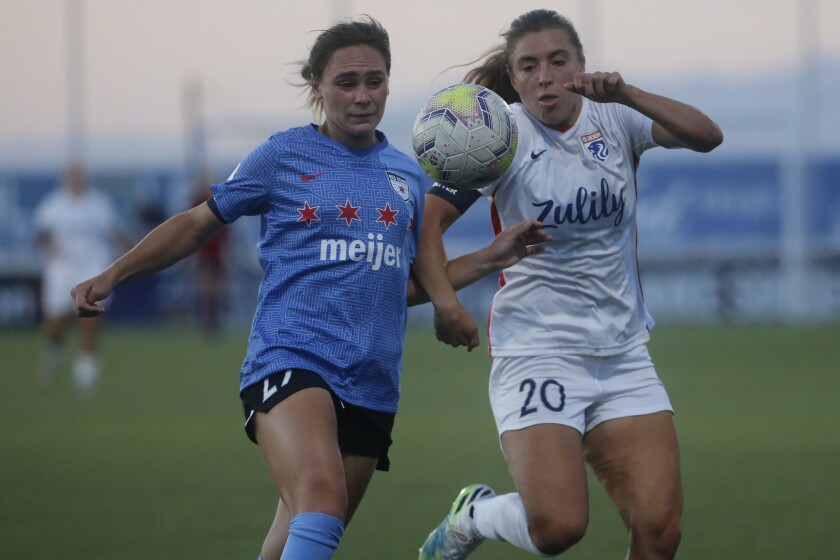 Chicago Red Stars' Bianca St. Georges and Reign's Sofia Huerta battle for the ball during an NWSL Challenge Cup match.