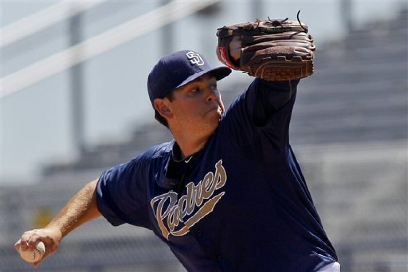 San Diego Padres starting pitcher Tim Stauffer works the first inning against the Milwaukee Brewers in a spring training baseball game Saturday, March 31, 2012 in Peoria. Ariz. Stauffer surrendered 6 runs on seven hits in five innings. (AP Photo/Lenny Ignelzi)