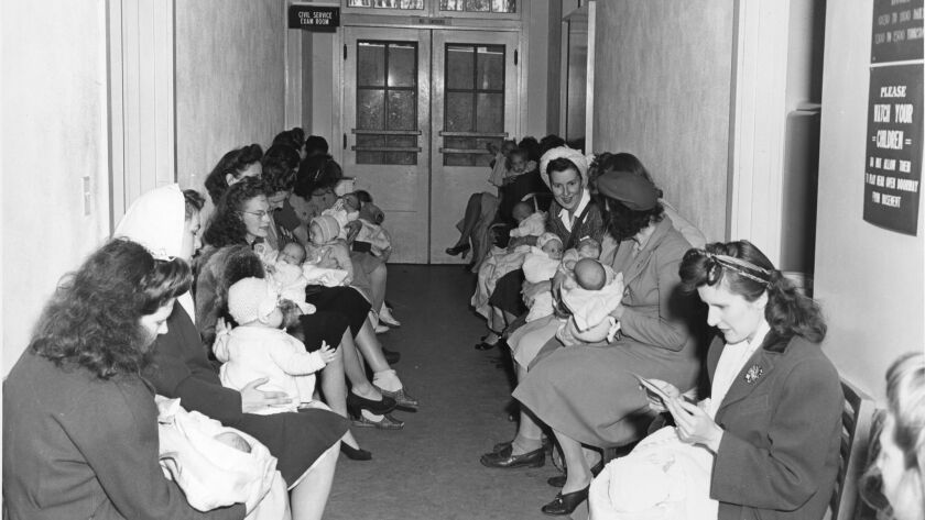 Navy mothers wait for their turn at the Balboa Park hospital's well-baby clinic, which occupied a bu