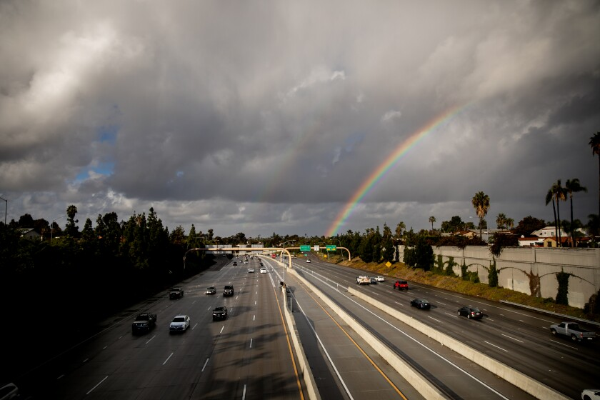 A rainbow forms over Interstate 15
