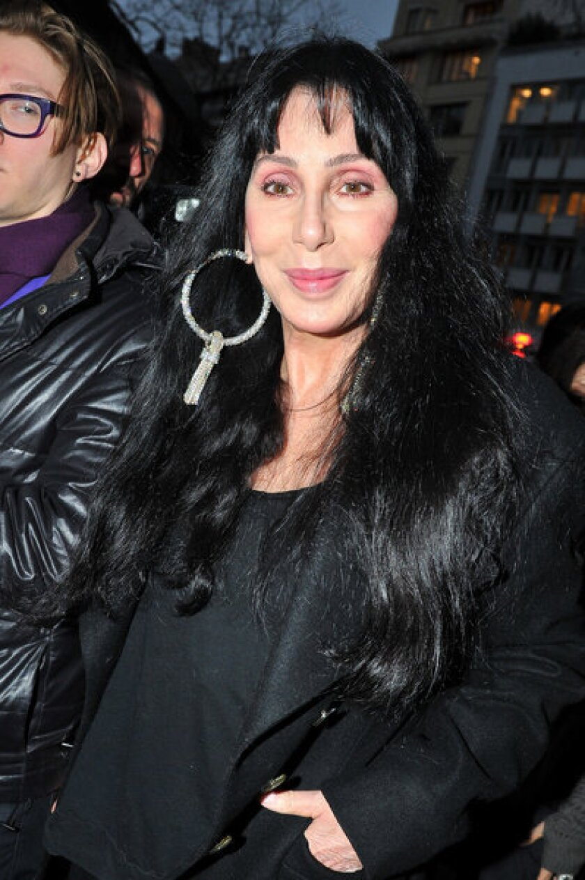 Cher attends a Paris fashion show.