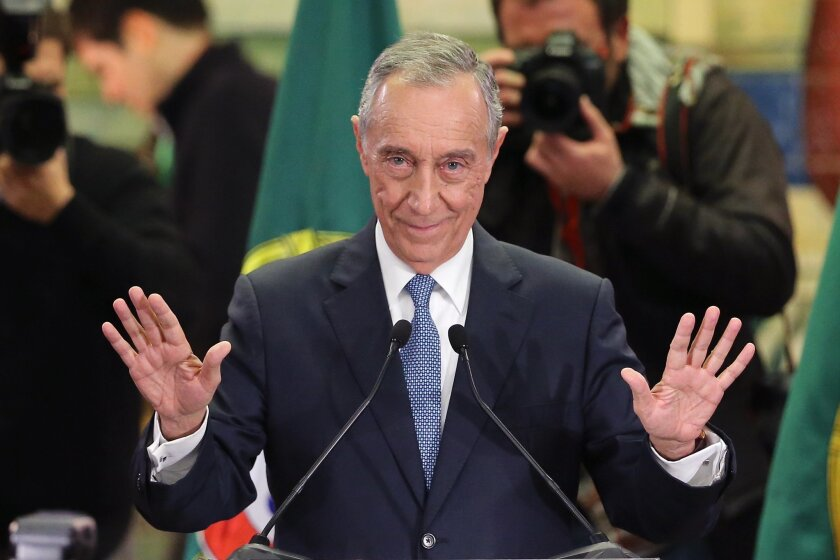 Marcelo Rebelo de Sousa addresses journalists and supporters after winning Portugal's presidential election Sunday, Jan. 24, 2016, in Lisbon. Rebelo de Sousa, a veteran center-right politician who became a popular television personality, recorded an emphatic victory in Portugal's presidential election on Sunday, collecting more than half of the votes against nine rivals as the Portuguese chose a counterweight to the country's center-left Socialist government. (AP Photo/Armando Franca)