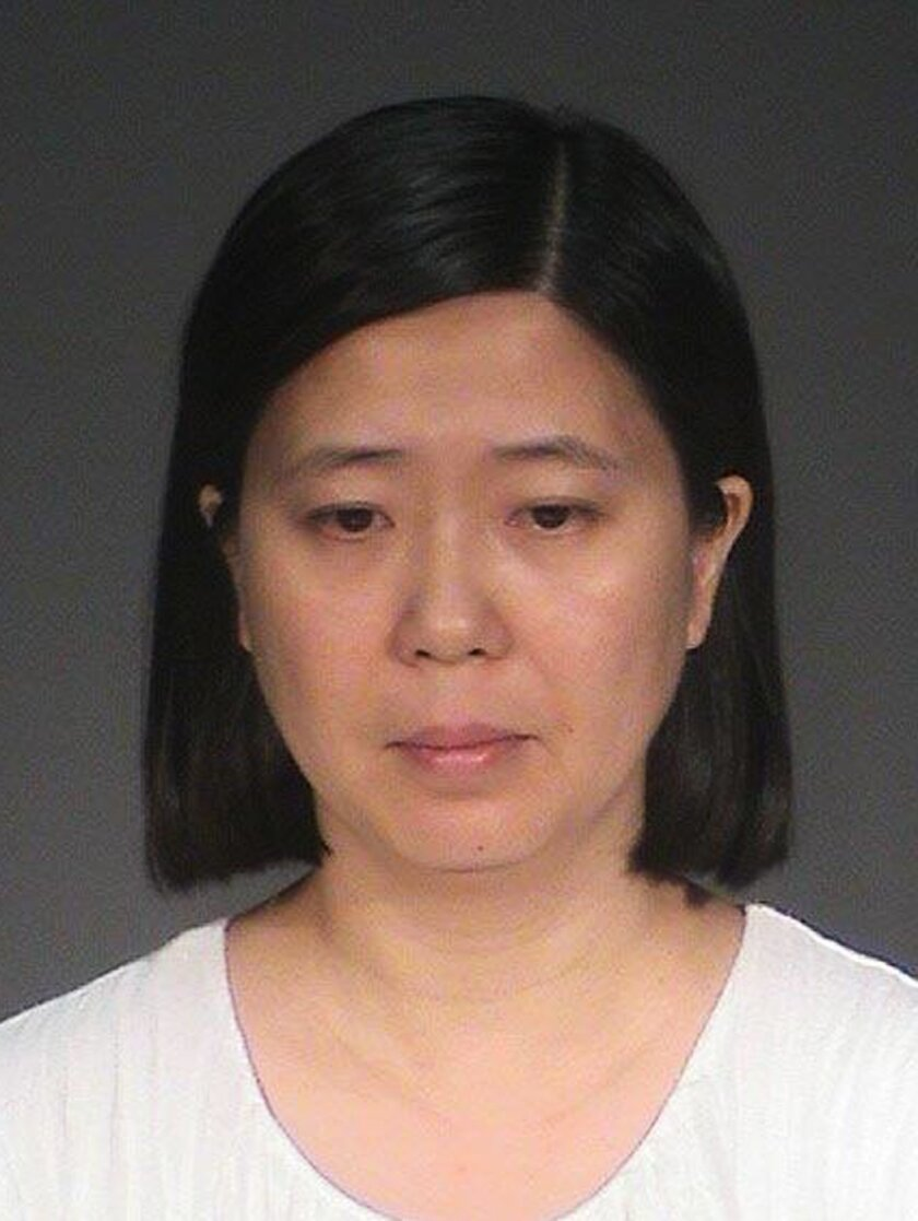This photo provided by the Washington County Jail shows Lili Huang. The Minnesota woman, of Woodbury, is charged in Washington County with five felony counts, including labor trafficking, false imprisonment and assault. Huang remains in jail after making her initial court appearance Friday, July 15