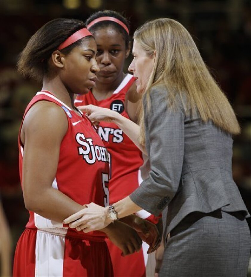 St. John's coach Kim Barnes talks with guard Nadirah McKenith (5) during the first half against Stanford in a second-round NCAA women's college basketball tournament game in Stanford, Calif., Monday, March 21, 2011. (AP Photo/Paul Sakuma)