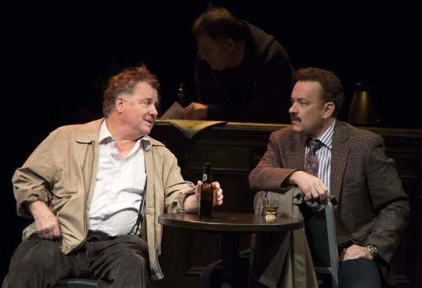 """This theater image released by Boneau/Bryan-Brown shows  Peter Gerety as editor John Cotter, left, and Tom Hanks as tabloid columnist Mike McAlary during a performance of """"Lucky Guy,"""" playing at the  Broadhurst Theatre in New York.  (AP Photo/Boneau/Bryan-Brown, Joan Marcus)"""