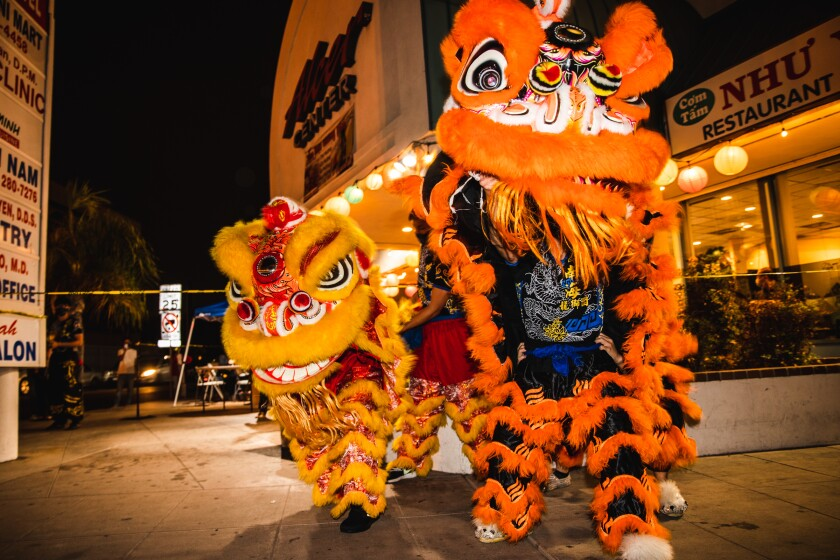 Lion dancers perform in front of Nhu Y, a restaurant in City Heights' Little Saigon community Nov. 6.