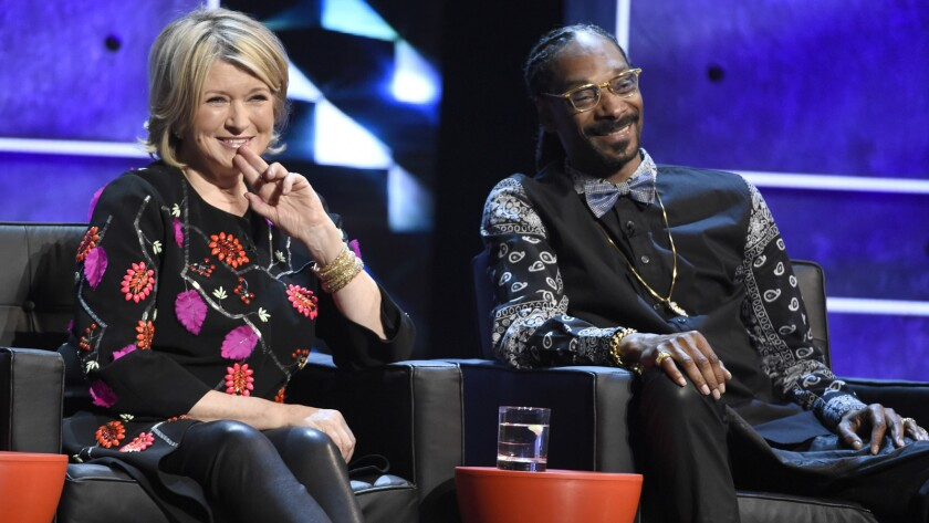 """Martha Stewart and Snoop Dogg at the Comedy Central Roast of Justin Bieber. The two are hosting a new show on VHI called """"Martha and Snoop's Potluck Dinner Party."""""""